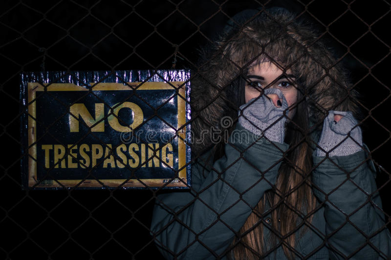 Woman next to no trespassing sign royalty free stock image