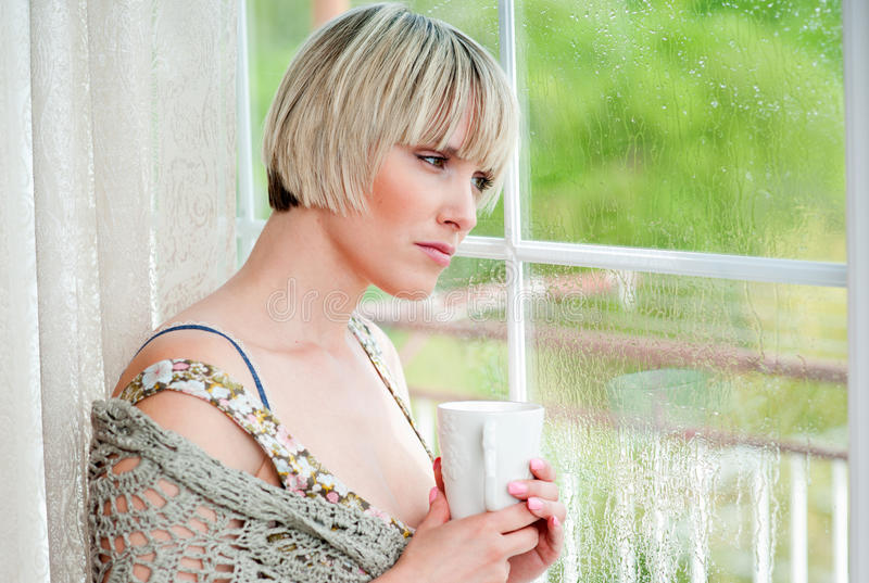 Woman next to window in the morning