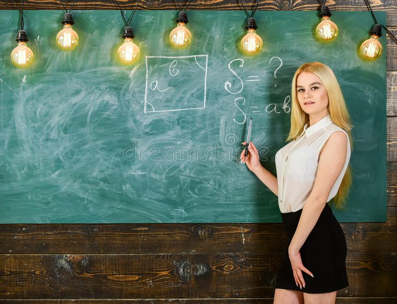 Woman with nice buttocks teaching mathematics. teacher concept. Lady teacher in short skirt explaining formula stock images