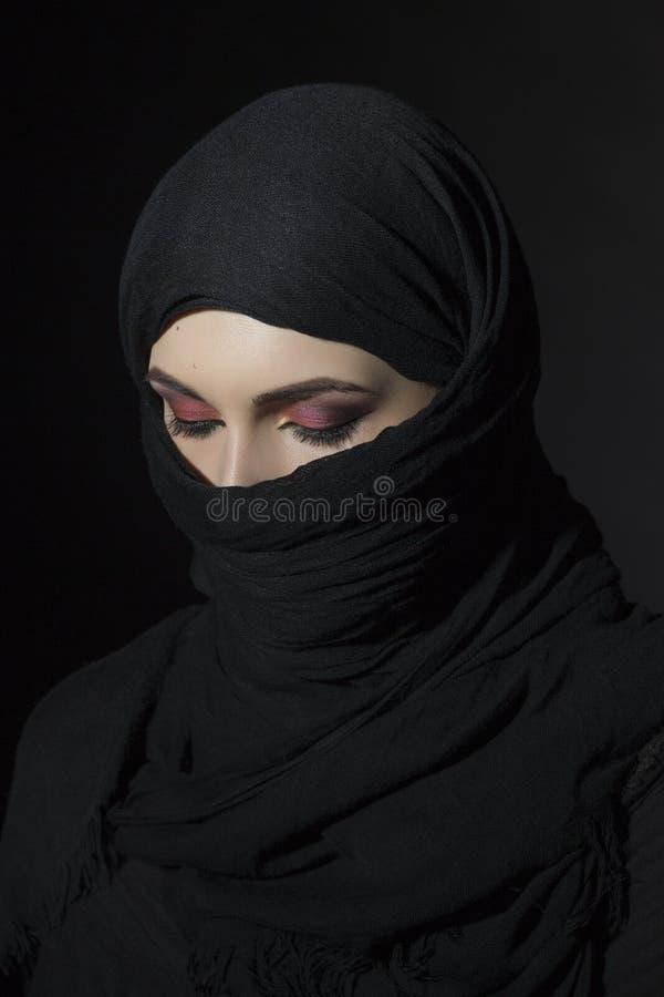 Woman in niqab stock photo