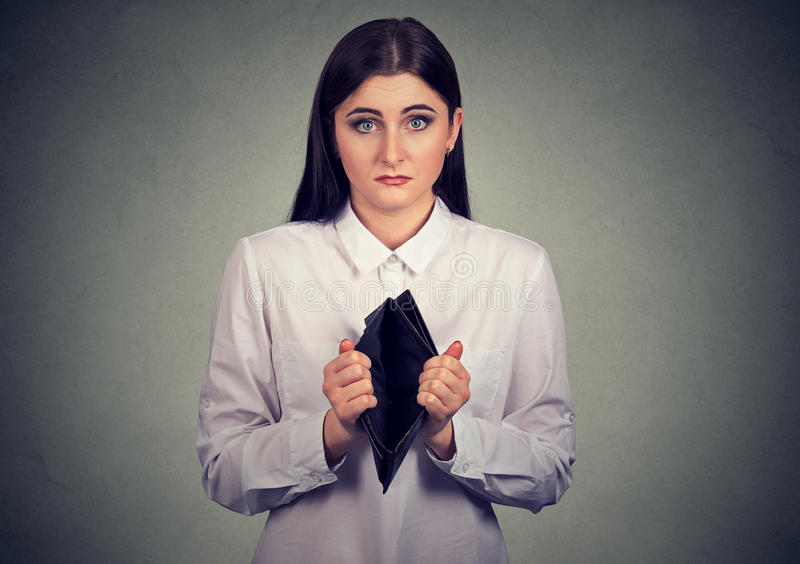 Woman with no money. Businesswoman showing empty wallet stock photo
