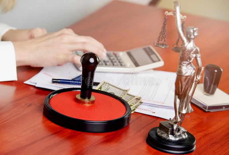 Woman Notary Public calculates the cost royalty free stock photos