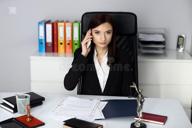 Woman notary public talking on her cell phone stock image