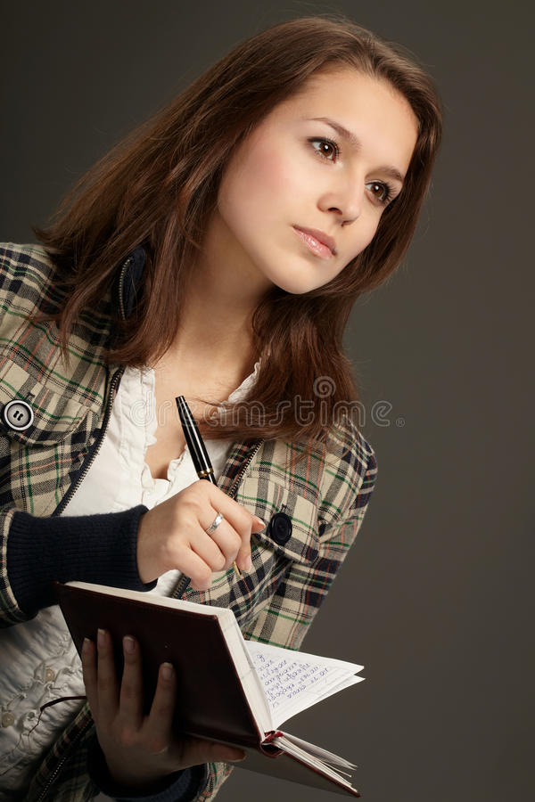 Woman with notebook stock photo