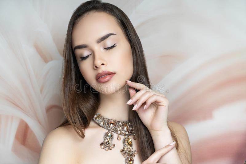 Woman nude make up, massive necklace royalty free stock photography