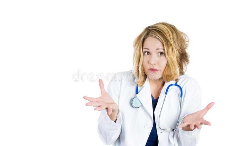 Woman nurse or doctor with overworked and stressed, asking question What to do now? royalty free stock image