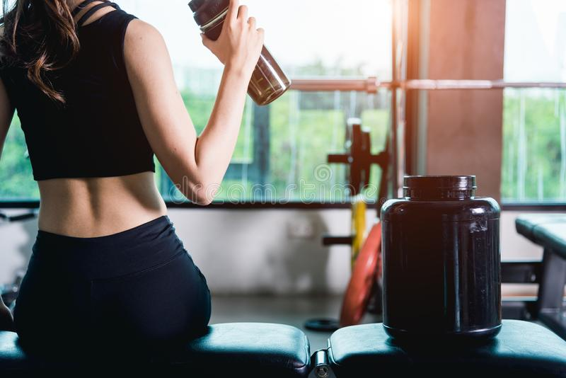 Woman nutrition shake protein for drinking after workout royalty free stock image