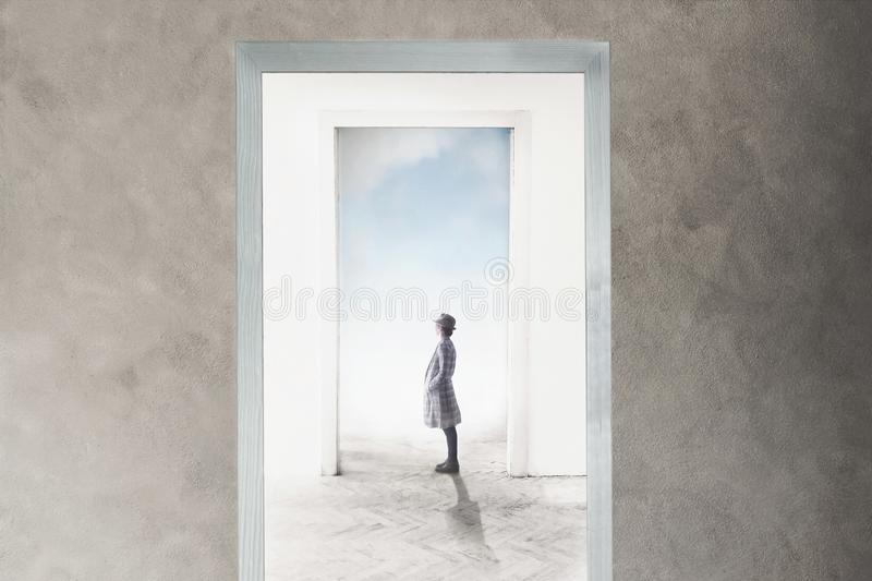 Woman observe curious the door that opens towards freedom and dreams royalty free stock images
