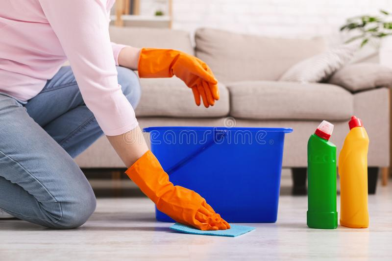Woman with obsessive compulsive disorder cleaning floor stock photography