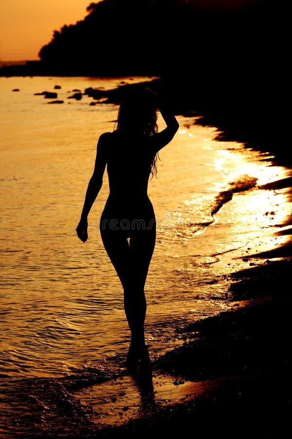 Download Woman in ocean stock image. Image of cloud, light, nature - 18443055