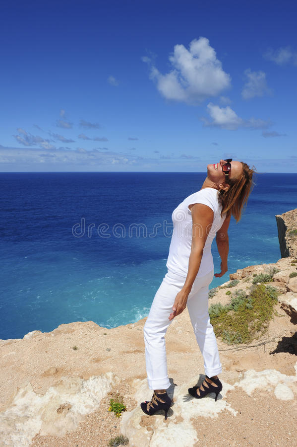 Woman at Ocean feeling Happy royalty free stock photos