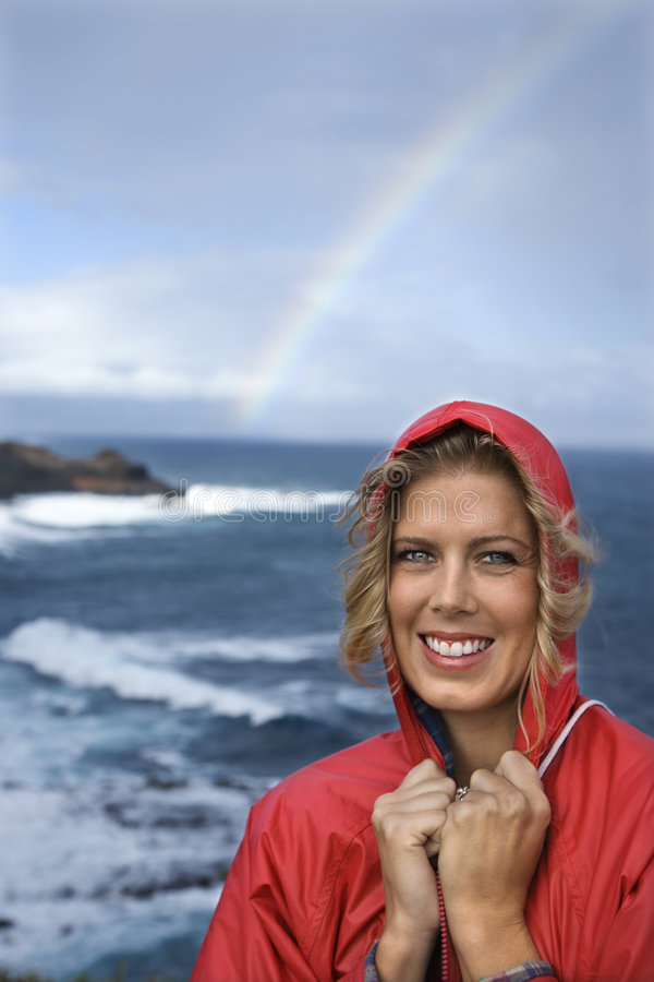 Woman by ocean and rainbow. royalty free stock images