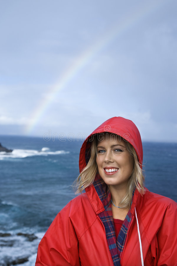 Woman by ocean and rainbow in Maui, Hawaii. royalty free stock images