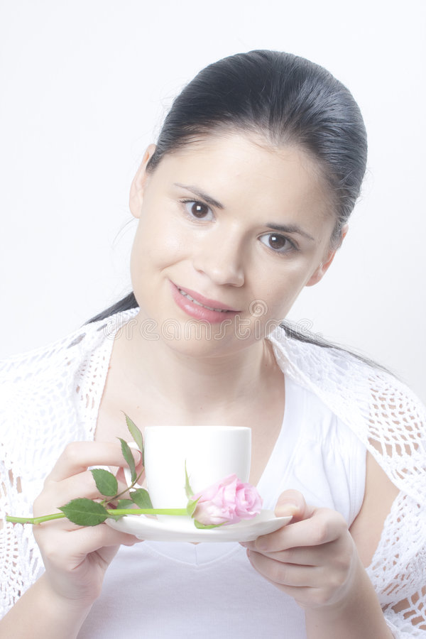 Woman offering coffee royalty free stock photos