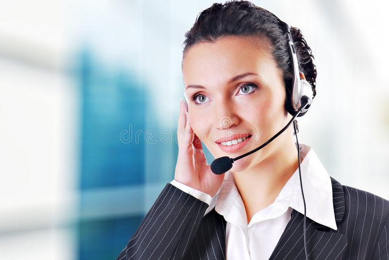 Woman in office. Woman wearing headset in office; could be receptionist royalty free stock photography