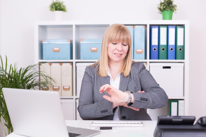 Woman at the office having time pressure. Business concept stock photos