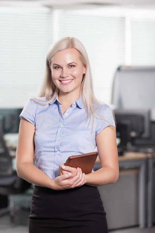 Woman at office. Smart and intelligent girl at office stock photography