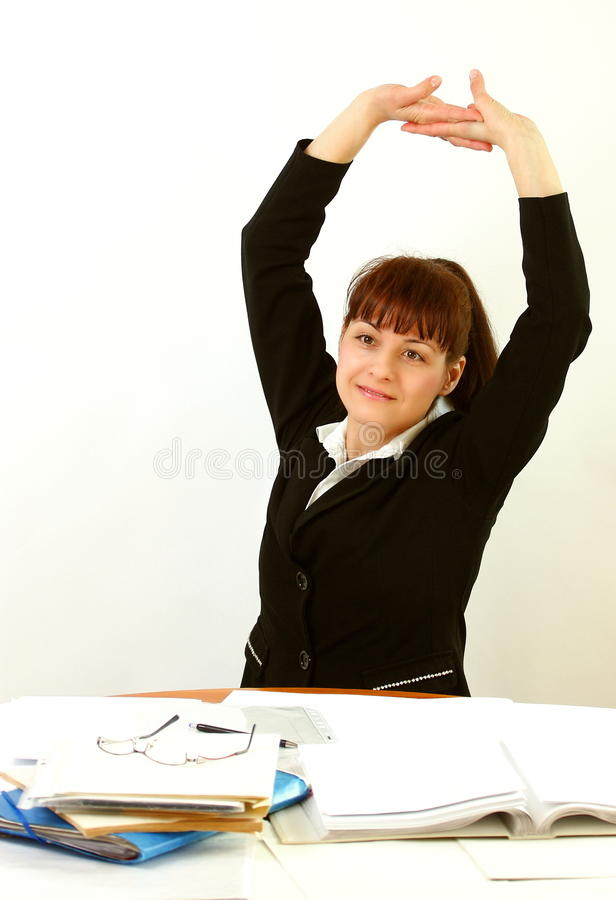 Woman in office stretching stock photos
