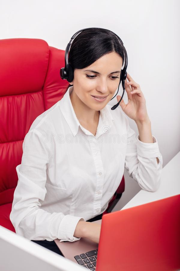Woman in office talking on the headset royalty free stock image