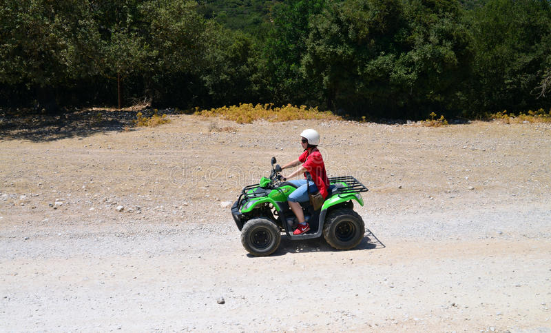 Woman offroad trip. ARKADI, GREECE woman outdoors ATV offroad trip royalty free stock images