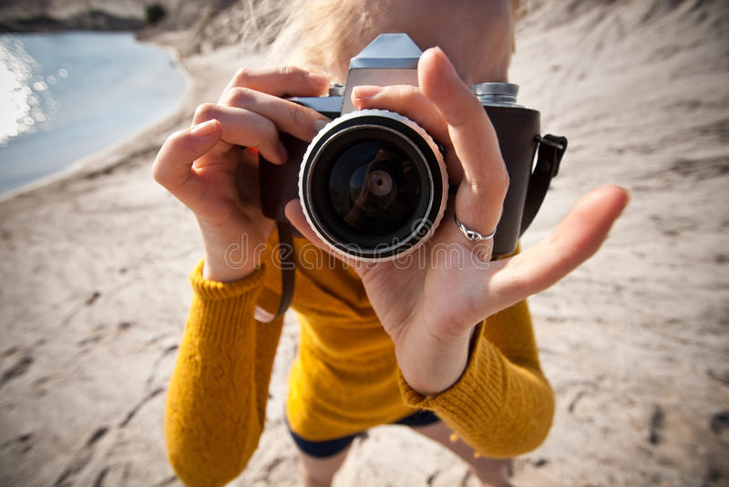 Woman with a old camera stock photo