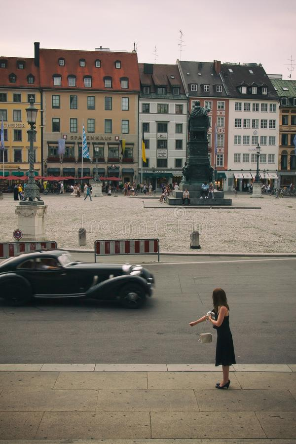 WOMAN AND THE OLD CAR royalty free stock photography