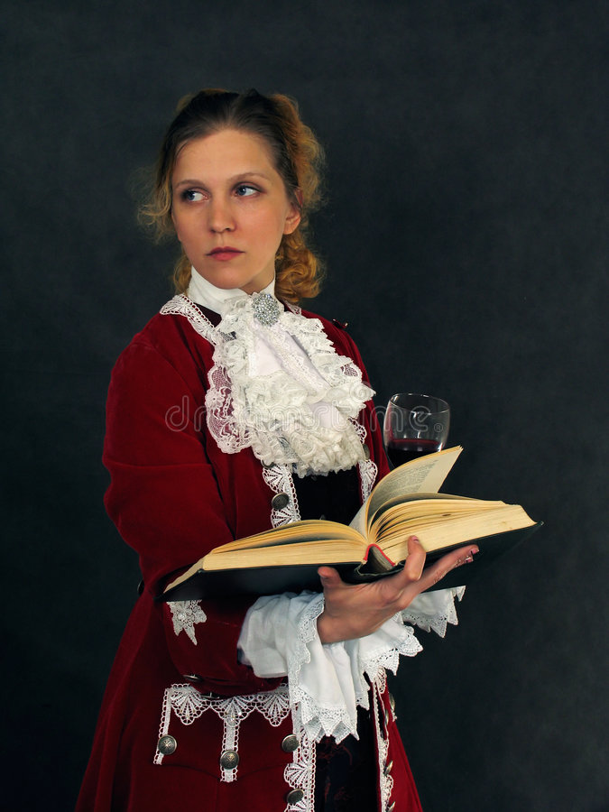 Woman in old-fashioned french clothes with a book royalty free stock photos