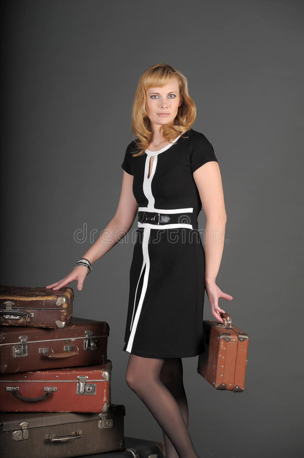 Download Woman And Old Suitcases Royalty Free Stock Image - Image: 22273246