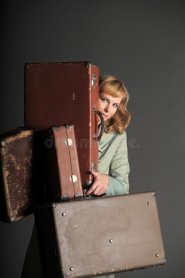Download Woman and old suitcases stock image. Image of attitude - 22273389
