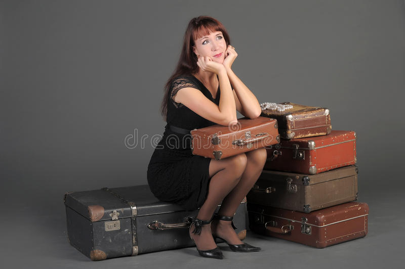Download Woman and old suitcases stock image. Image of attitude - 22274103