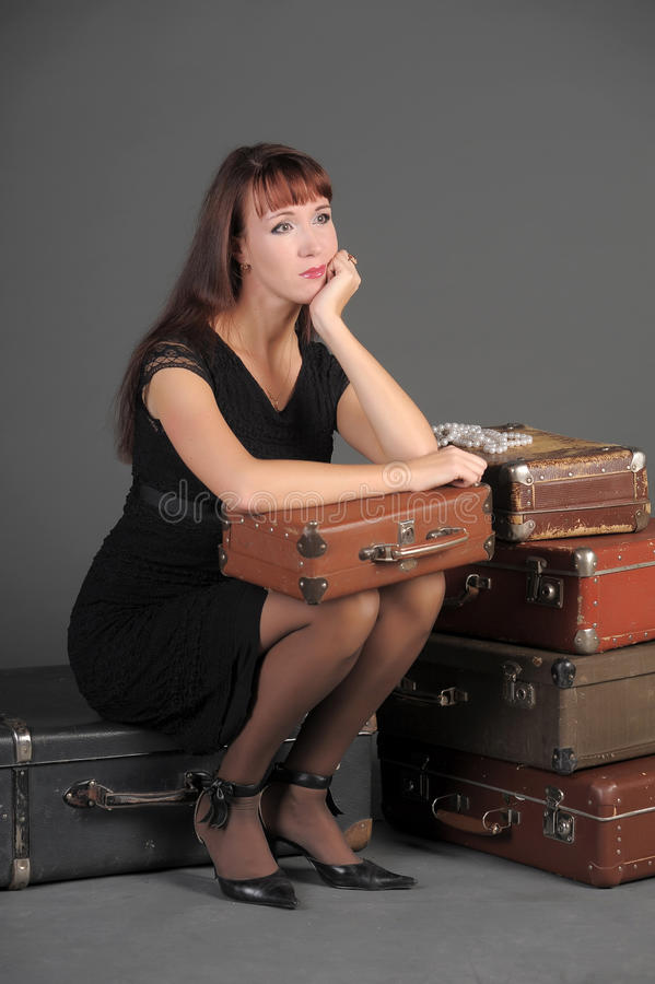 Woman and old suitcases