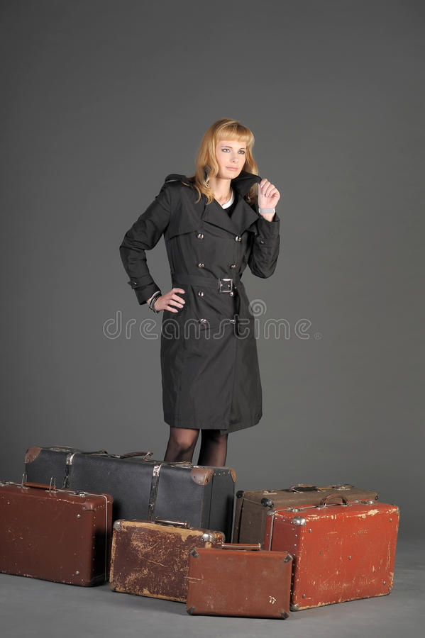 Download Woman and old suitcases stock image. Image of cute, attitude - 22274459