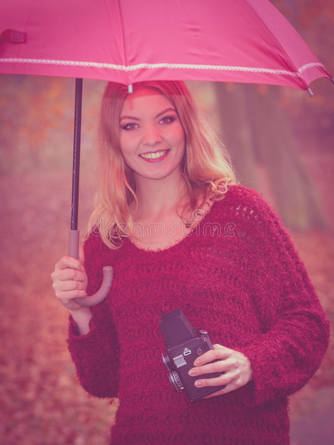 Woman with old vintage camera and umbrella. royalty free stock photo