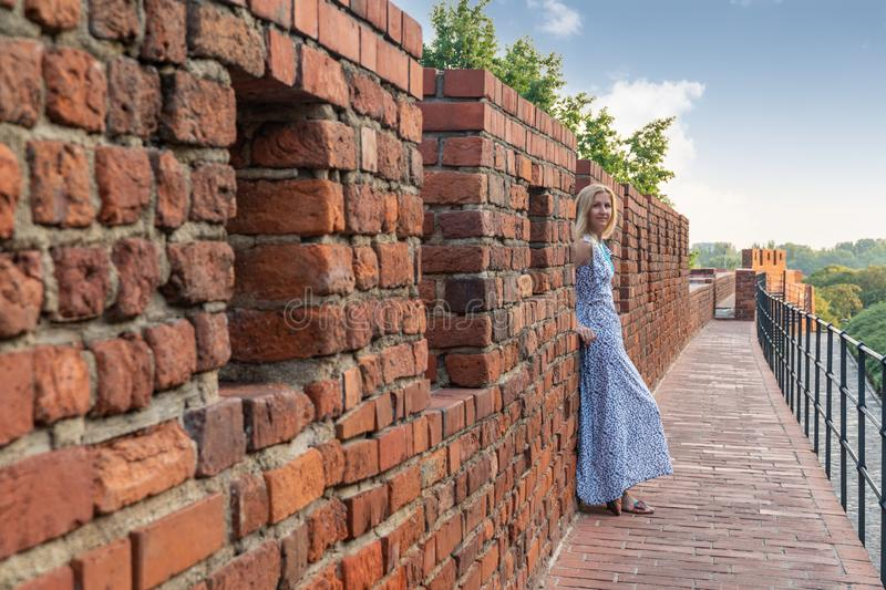 Woman at the old wall royalty free stock image