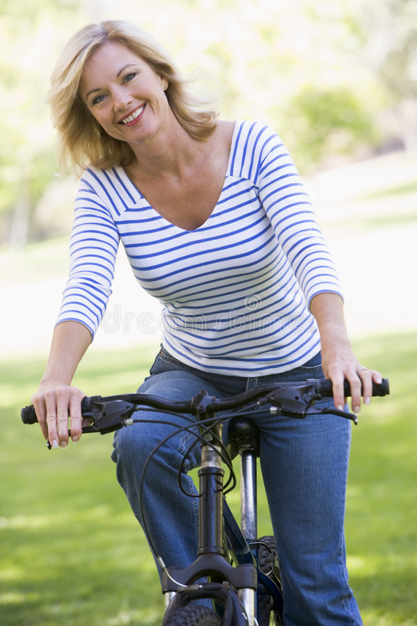 Free Woman On Bike Outdoors Smiling Stock Photography - 5539372