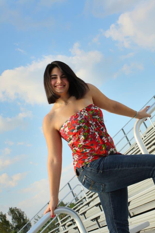 Free Woman On Bleachers Stock Photography - 5015082