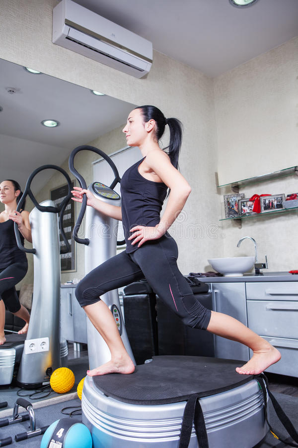 Free Woman On Trainer Machine In Sport Gym Stock Images - 25396854