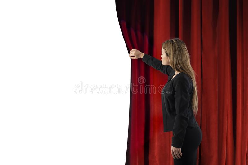 Woman open red curtains of the theater stage. blank space for your text stock images