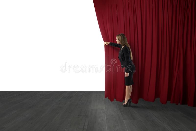 Woman open red curtains of the theater stage. blank space for your text royalty free stock photography