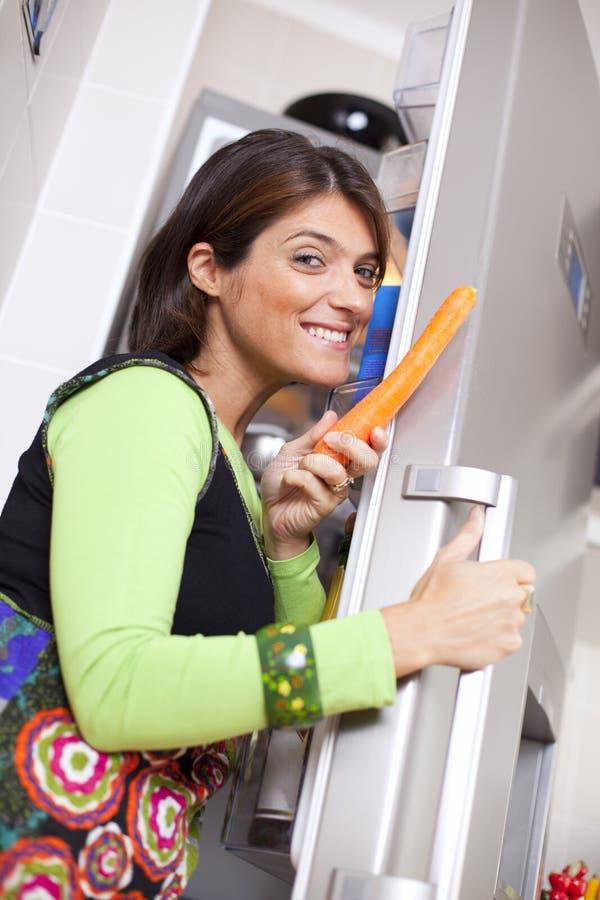 Woman open the refrigerator door royalty free stock image