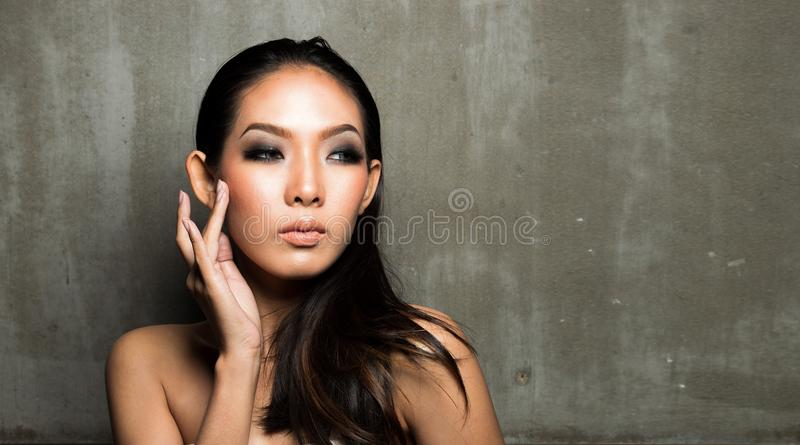 Woman open shoulder, fashion make up wet look stock photography