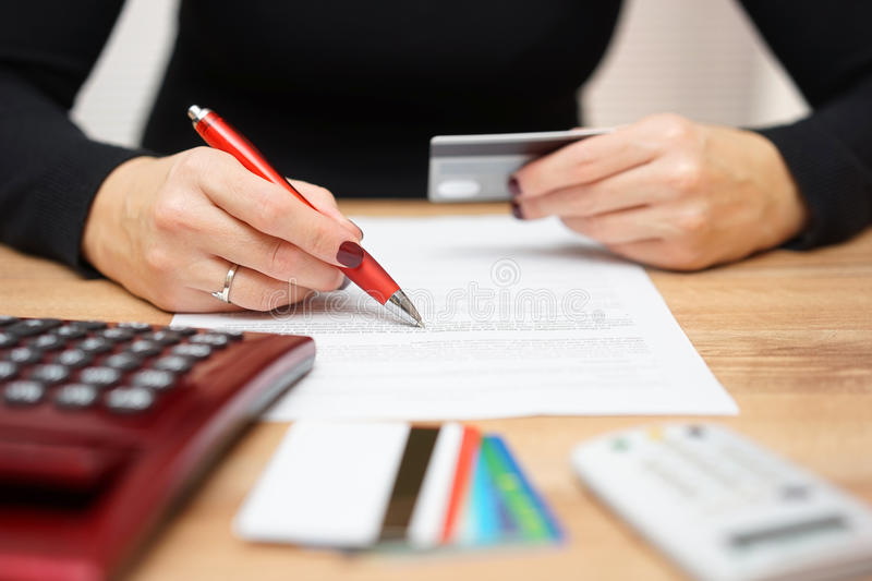 Woman is opening bank account and checking credit card informat royalty free stock image
