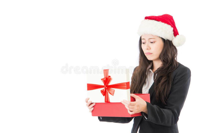 Woman opening Christmas gift disappointed and unhappy royalty free stock photo