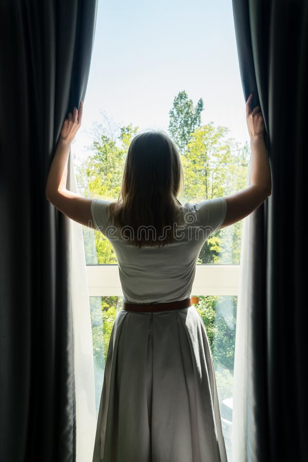 Free Woman Opening Curtains Stock Photo - 155804800