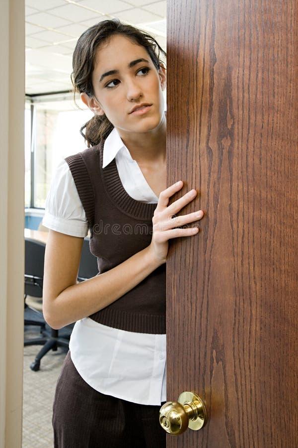 Woman opening door stock photos