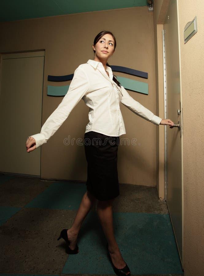 Woman opening the doors stock photos