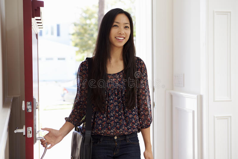 Woman Opening Front Door Of Home After Day At Work royalty free stock photos