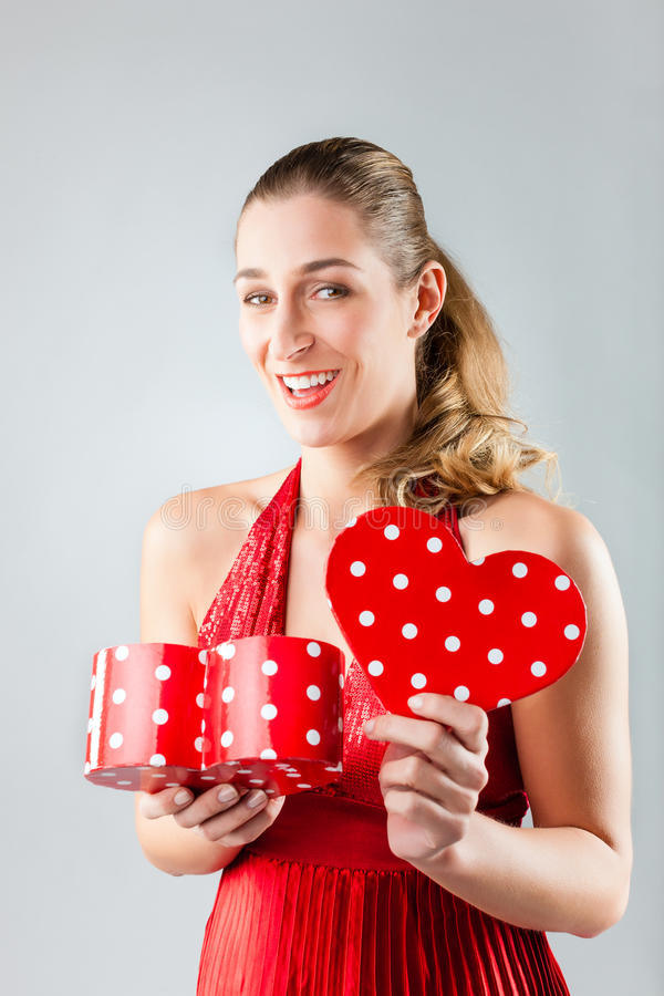 Woman Opening Present For Valentines Day Stock Photos