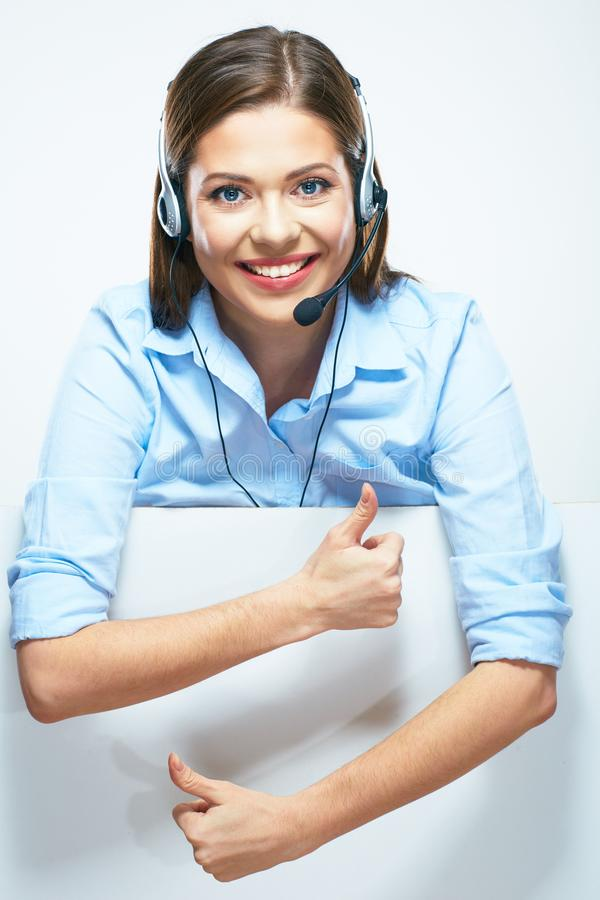 Woman operator with headset and blank sign board showing thumbs. Up. Isolated portrait of smiling help line operator royalty free stock photo