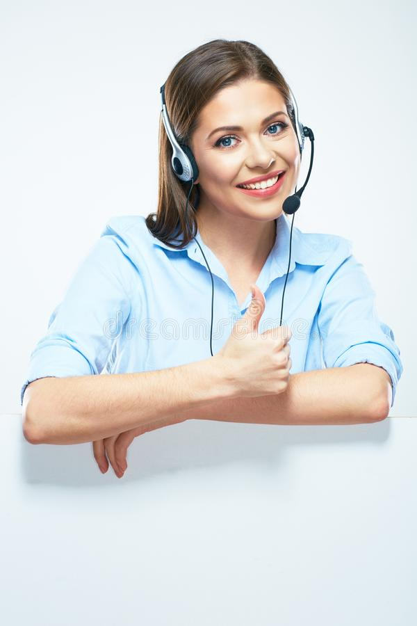 Woman operator with headset and blank sign board showing thumbs. Up. Isolated portrait of smiling help line operator stock images